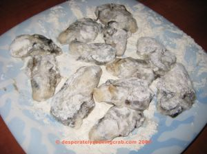 Oysters Dusted in Flour Ready for the Egg