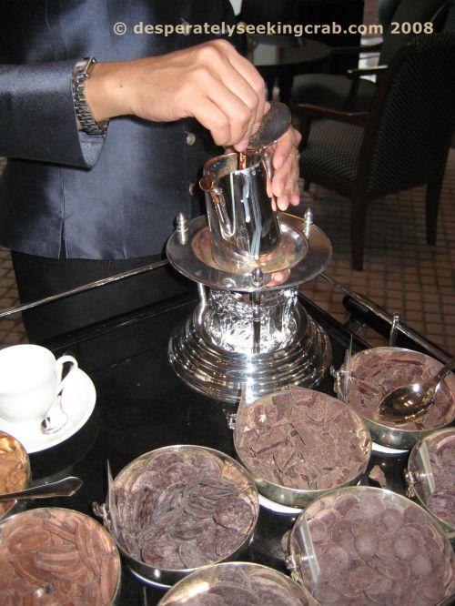 Attendant mixing the hot chocolate